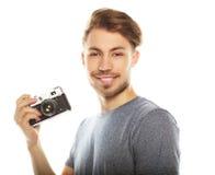 有照相机的年轻人 查出在空白背景 库存照片