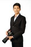 有照相机的年轻摄影师 图库摄影