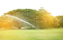 有爆炸光的喷泉中央公园 库存图片