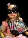 有爱好者的在礼服的女孩和面具 免版税库存图片