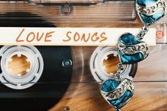 有爱情歌曲的卡型盒式录音机磁带 免版税库存照片