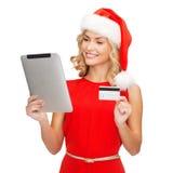 有片剂个人计算机和信用卡的妇女 库存照片