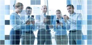 有片剂个人计算机和智能手机的商人 免版税库存图片