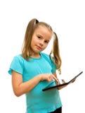 有片剂个人计算机的一个女孩。 库存图片