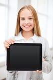 有片剂个人计算机的女孩在学校 库存照片