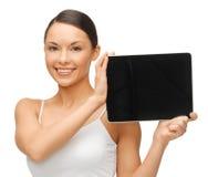 有片剂个人计算机的妇女 免版税库存照片
