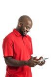 有片剂个人计算机的英俊的黑人 库存图片