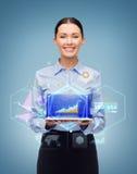 有片剂个人计算机计算机的微笑的女实业家 图库摄影