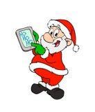 有片剂的圣诞老人 免版税库存照片