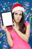 有片剂的惊奇的圣诞节女孩 库存图片