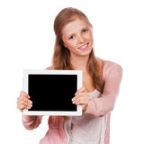 有片剂的年轻秀丽学生女孩 库存照片