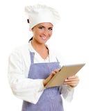 有片剂计算机的微笑的首要厨师。 图库摄影