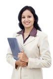 有片剂计算机的愉快的女商人 免版税图库摄影
