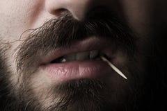 有牙签的人 免版税库存照片