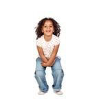 有牛仔裤的美丽的非洲孩子 免版税库存照片