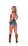 有牛仔裤的肉欲的美好的女孩后面短缺 库存照片