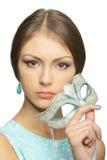 有狂欢节面具的女孩 免版税库存照片
