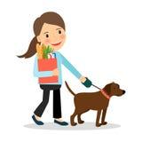 有狗和袋子的妇女食物 皇族释放例证
