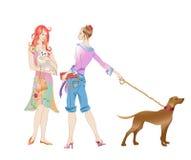 有狗的二个女孩 免版税图库摄影
