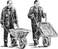 有独轮车的工作者 免版税库存照片