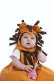 有狮子屏蔽的婴孩 免版税库存图片