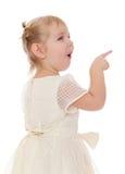 有猪尾展示赞许的白肤金发的女孩 库存照片