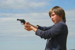有玩具手枪的新男孩 库存照片