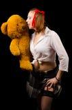 有玩具熊的性感的女小学生 免版税库存图片