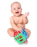 有玩具的婴孩在白色 图库摄影