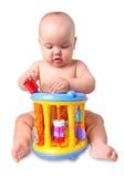 有玩具的婴孩在白色 免版税图库摄影