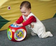 有玩具的婴孩 免版税库存照片