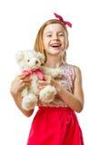有玩具的小微笑的逗人喜爱的女孩在她的手上 免版税库存照片