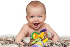 有玩具的微笑的孩子 免版税库存照片