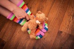 有玩具的手 免版税库存照片
