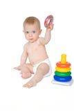 有玩具的逗人喜爱的婴孩 库存照片