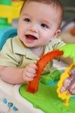 有玩具的逗人喜爱的男婴 免版税库存照片