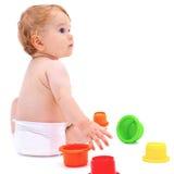 有玩具的逗人喜爱的婴儿男孩 图库摄影