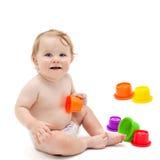 有玩具的逗人喜爱的婴儿男孩 免版税库存图片