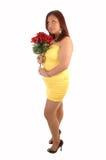 有玫瑰的充分的判断的女孩。 免版税库存图片