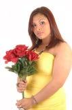 有玫瑰的女孩。 库存图片