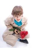 有玫瑰的微笑的男孩 免版税库存照片