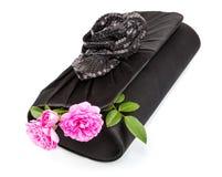 有玫瑰的黑色手袋 库存照片