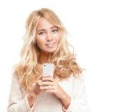 有现代电话的新俏丽的妇女在白色。 免版税库存图片
