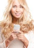 有现代电话的新俏丽的妇女在白色。 库存照片