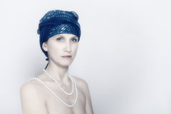 有珍珠的妇女 免版税库存图片