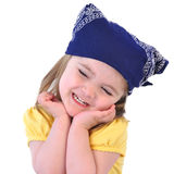 有班丹纳花绸帽子的小女孩在白色 库存照片