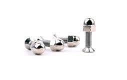 有球状坚果的镀铬物螺栓 免版税库存照片