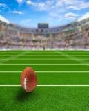 有球的橄榄球场在领域和拷贝空间 库存图片