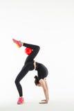 有球的节奏性体操运动员在演播室 免版税库存照片