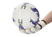 有球的足球守门员在他的手上 免版税库存图片